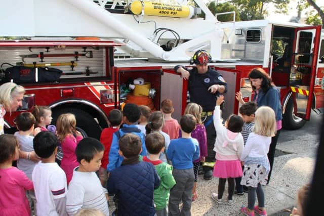 Pleasantville volunteer firefighters gave tours of trucks and talked about fire safety during a recent visit to Bedford Road School in Pleasantville.