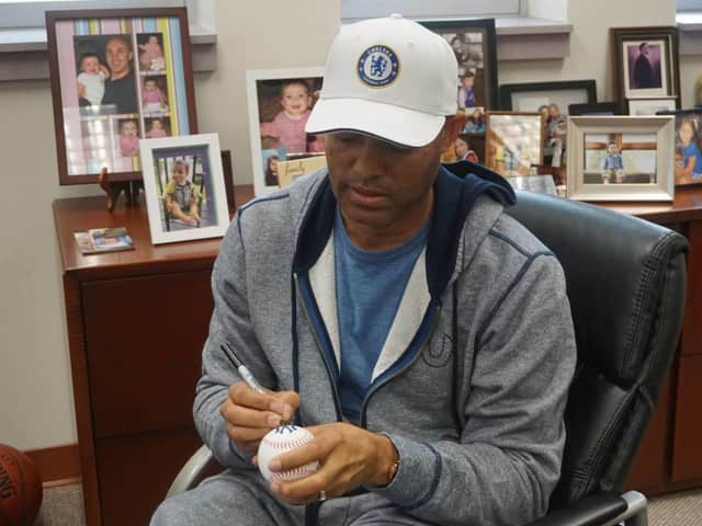 Mariano Rivera signing baseballs for New Rochelle elementary school students.
