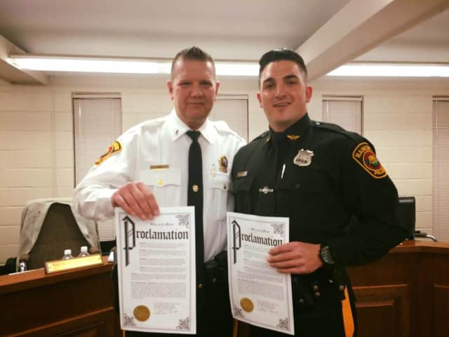 Lieutenant Thomas Ryan and Officer James Divite were honored with proclamations for their work in subduing an emotionally disturbed man.