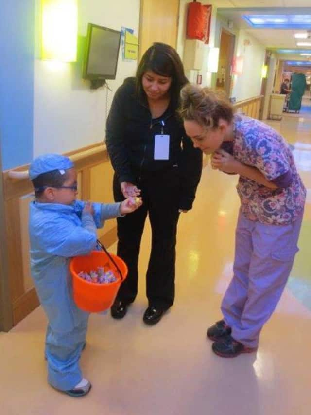 A child trick-or-treats at Sunshine Children's Home and Rehab Center. The home is trying to expand from 54 to 122 beds.