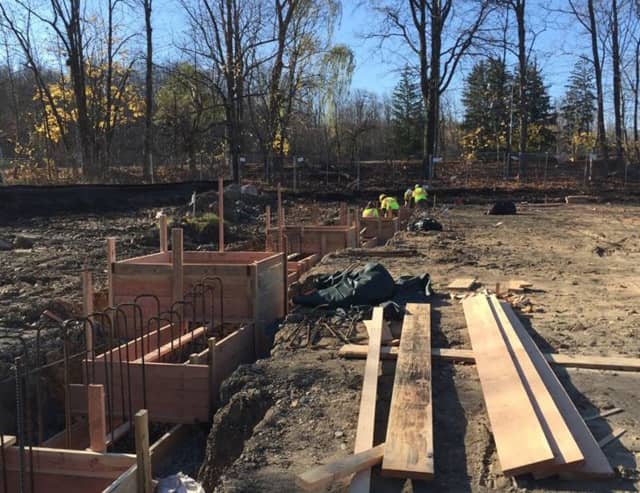 Workers lay the foundation at the site of the new West Milford Township Library.