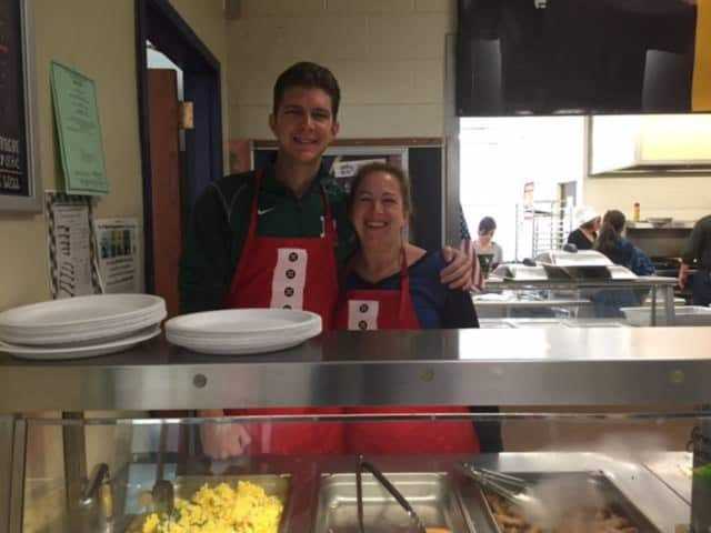 Middle School administrators Viv Ossowski and Don Marra led volunteers at Saturday's pancake breakfast.