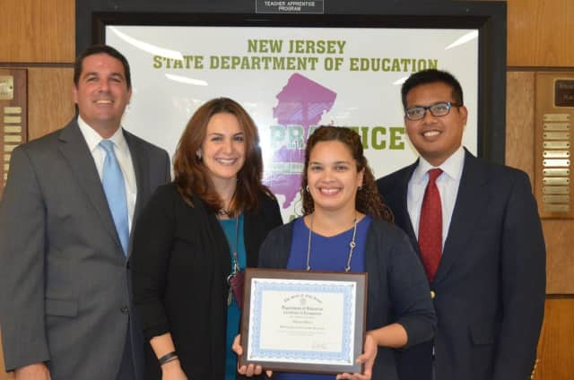 Bergenfield administrators stand alongside BHS English Teacher Susan Baez, who was recently honored in the state's Exemplary Educator Recognition Program.