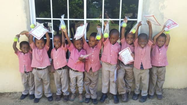 Children in Jamaica celebrate a gift given by the RKM Foundation. A Wyckoff gym will hold a fundraiser for the organization Jan. 30.