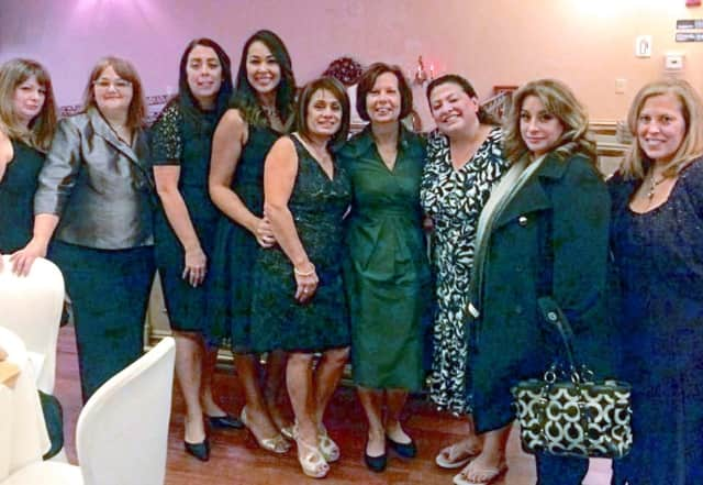 Starfish Award Recipient Melanie Boyan (center, in green) and the 2015-16 FLASE officers