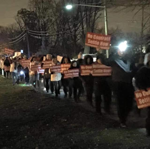 People rally in support of the teachers' union before an Elmwood Park Board of Education meeting.