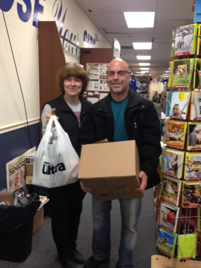 People donate to the 4 Paws Pet Food Pantry in Pompton Lakes.