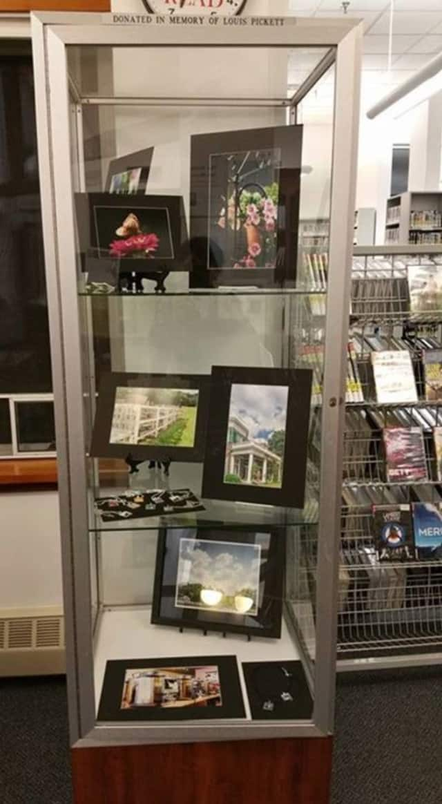 Some of Denise Farro's photo art on display at the library.