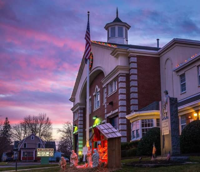 The Nativity Scene outside the New City Fire Department at sunset.