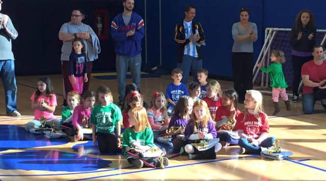 Saddle Brook youth soccer players receive trophies at the end of the year pizza party.
