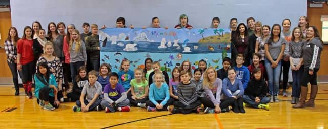 Haskell School students show off their art work.