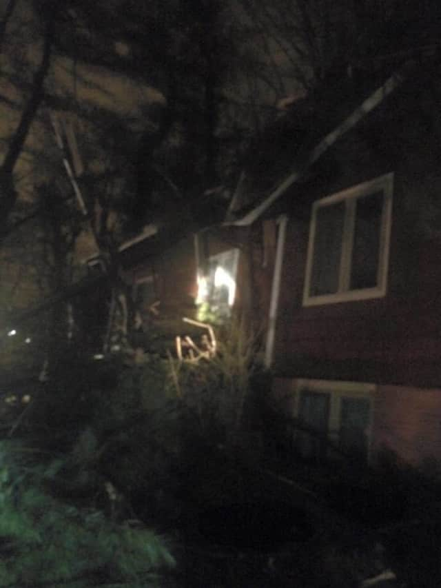 A large spruce tree fell on a house in Croton during Wednesday's storm, leaving a hole in the roof.