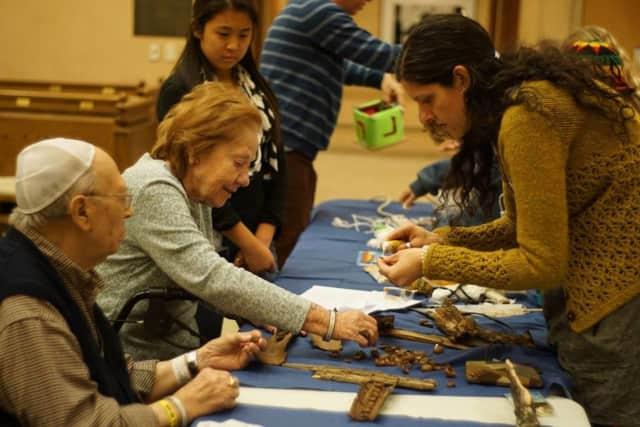 Volunteers work with residents at Jewish Home Family in Rockleigh.