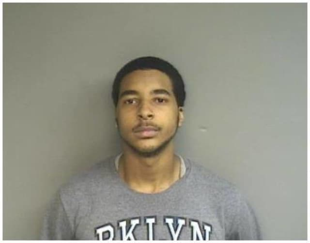 Caleb Newell, 20, of Stamford was arrested on robbery charges Wednesday in Stamford.