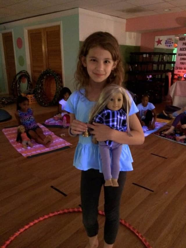 Bring your American Girl Doll to Ho-Ho-Kus Yoga for a session together.