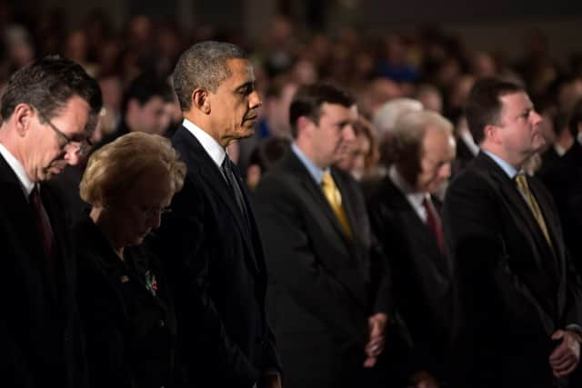 President Barack Obama visits families and takes part in a memorial service in Dec. 16, 2012, two days after the deadly mass shooting at Sandy Hook Elementary School.