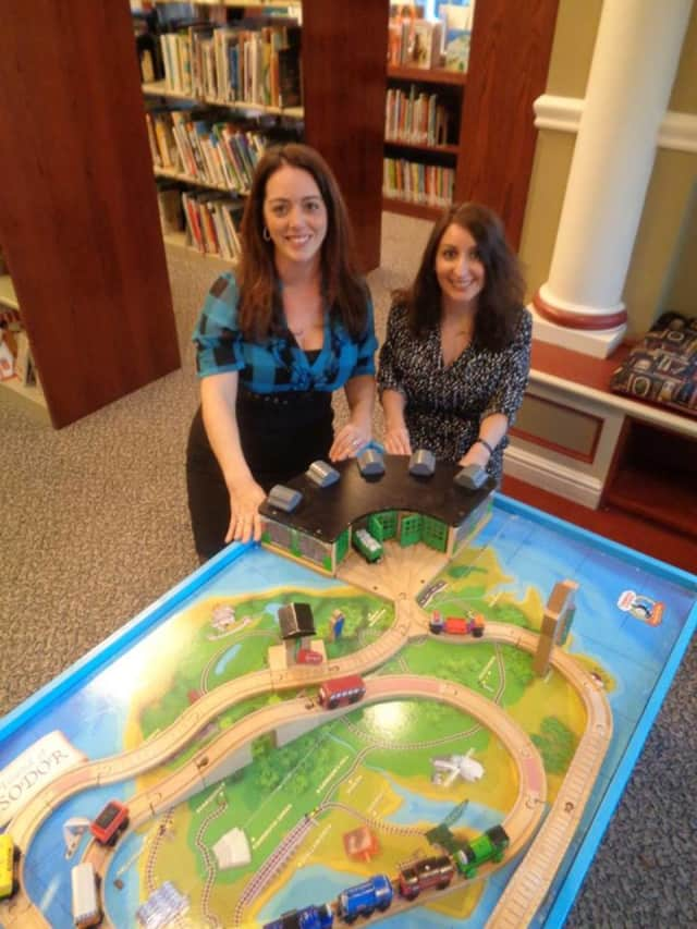 Kate Thompson of Coldwell Banker donated a train table to the Glen Rock Library.