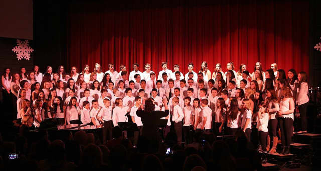 Seventh- and eighth-graders at Westlake Middle School raise their voices in song.