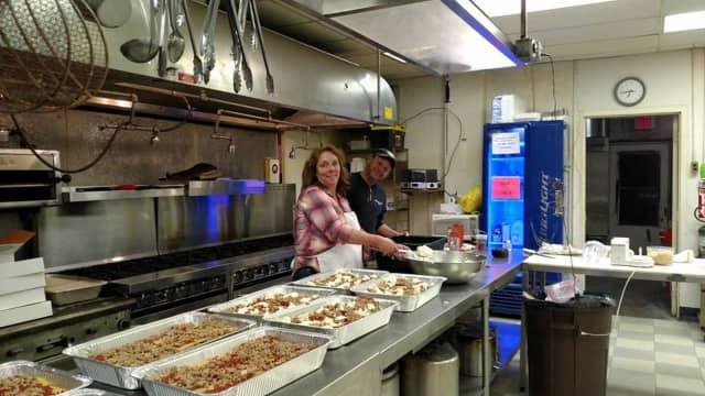 Kim Pow prepares food at the West Milford Elks Lodge.