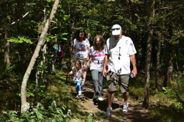 Hikers stroll through the woods during a previous Hike Against Addiction in Ringwood.