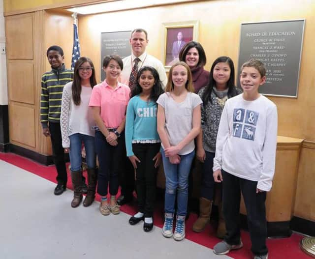 Bergenfield students Kevin Wood, Nicole Mallari, Angelica Castillo, Susan Johnson, Madison Kaszner, Angelica Amores, and Christian Guillen, with staffers Shane Biggins and Nicole Mackenzie.