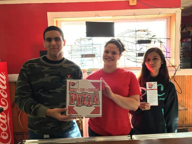 Garfield EPIC members place awareness stickers on the boxes at Garfield Brick Oven Pizza.