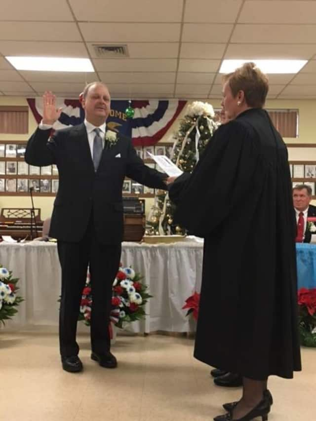 Mark Tomko being sworn in as mayor at the Wallington reorganization meeting.