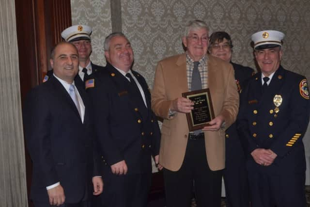 Former Mayor John van Keuren, seen here accepting an award from The Glen Rock Volunteer Fire Department, will be honored for his service to the borough at an event March 9.