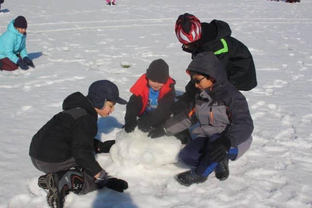 Pleasantville children play in the snow.