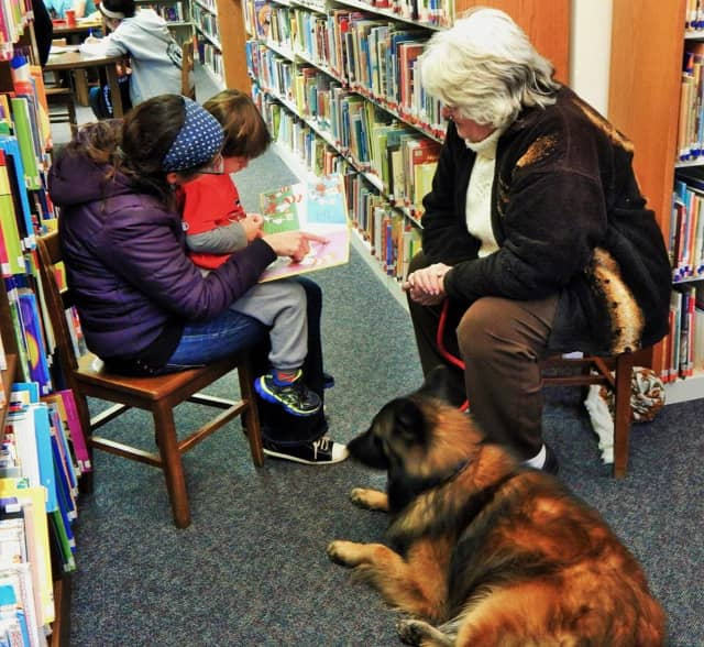 Kids read to a dog at the Pompton Lakes Library.