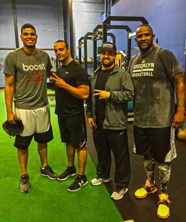 Elmwood Park's Dave Paladino, second to left, with New York Yankees pitchers Dellin Betances, at left, and CC Sabathia, at right.