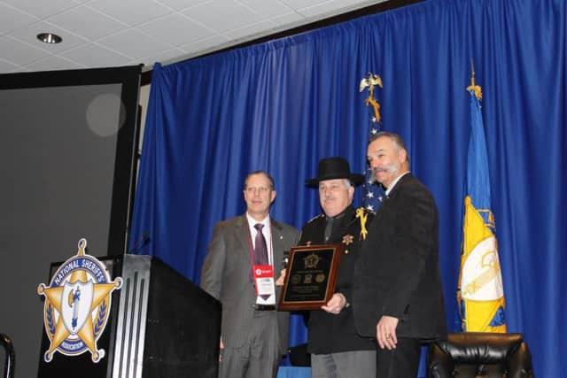 From left, National Sheriff's Association Executive Director Jonathan F. Thompson, Orange County Sheriff Carl E. DuBois and National Sheriff's Association President Sheriff Danny L. Glick, Laramie County, Wyoming.