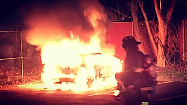 Firefighters put out a burning car on Boston Avenue in Stratford on Friday.