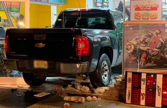 The pickup crashed through the front doors of the Quick Stop on Patterson Street in Hillsdale.