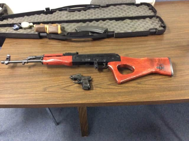 A Suffern man is facing weapons charges after officials found an AK-47 in his apartment.