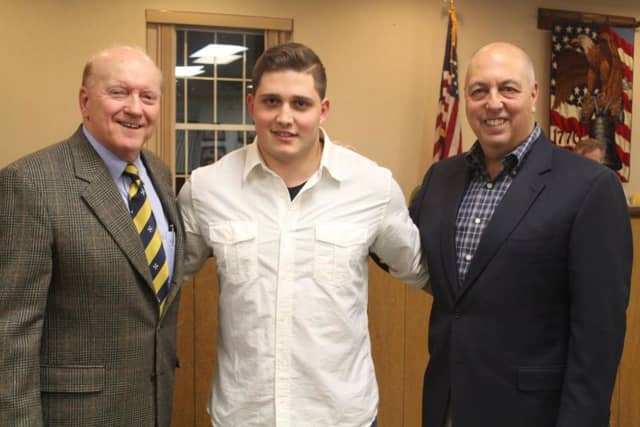 Franklin Lakes firefighter Nicola Touma, center, with Mayor Frank Bivona and and Councilman Thomas Lambrix.