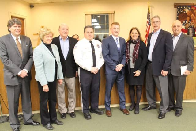 Franklin Lakes officials with the new police officers.