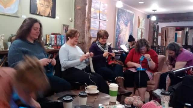 Spinning Yarn Knitters Club members take over the Enchanted Cafe in Red Hook while their regular meeting place at the Red Hook Library is undergoing renovations.