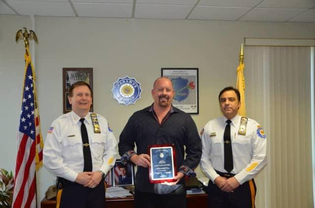 Paramus Police Lt. Steven Klink, center, served more than 25 years.