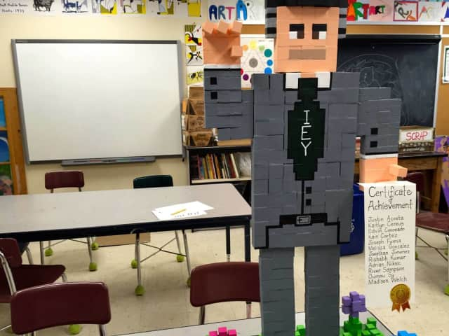 Identify who this man is. He was created by the sixth-grade students in Michael Fry's explorative art class at Isaac E. Young Middle School in New Rochelle.