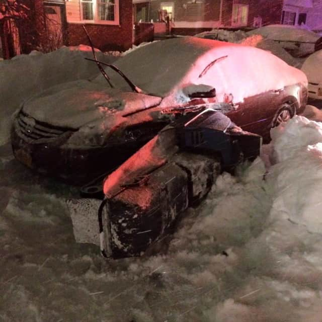 A 24-year-old man was arrested Saturday after crashing a snowmobile into a village police cruiser.