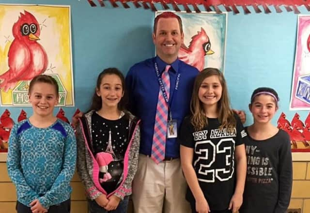 """Principal Scot Burkholde donned pink hair for the day when the kids met the """"Great Kindness Challenge."""""""