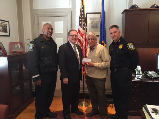 Mayor John Harkins presents the check.