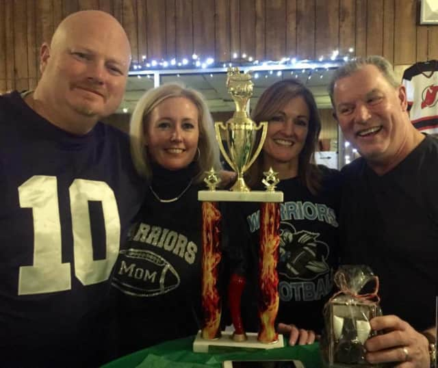 Kyle McKay, far left, takes home first place in the Midland Park Booster Association's Chili Cookoff. To his right is his wife, Patrice McKay, and friends Jan Casey and Ed Casey.
