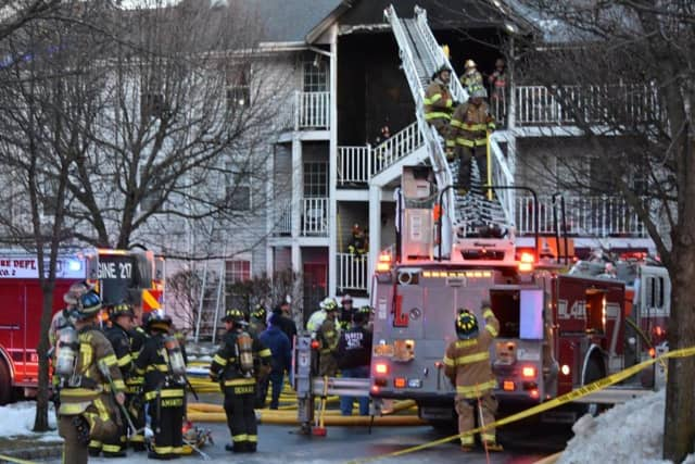 Mahwah firefighters extinguish the Society Hill condominium complex fire on Tuesday.