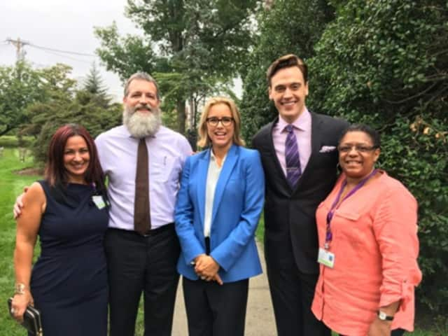 "Stars of CBS-TV's ""Madam Secretary,"" including Tea Leoni, with staff members at Wartburg in Mount Vernon."
