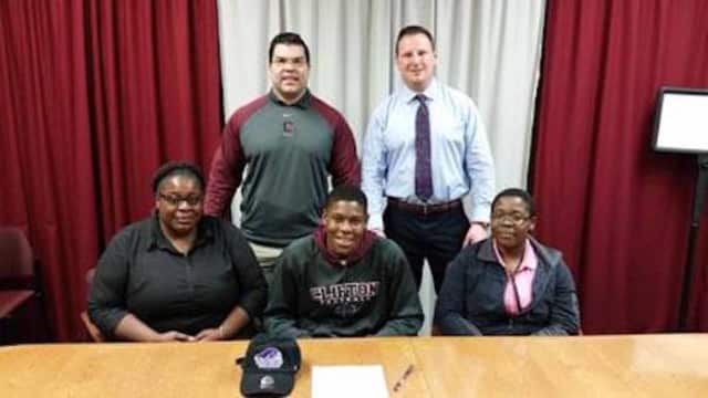 Maurice Greene sits with his mother Jacqueline Ghee, sister Naomi Addison, Head Coach Ralph Cinque and Athletic Director Tom Mullahey at signing day.