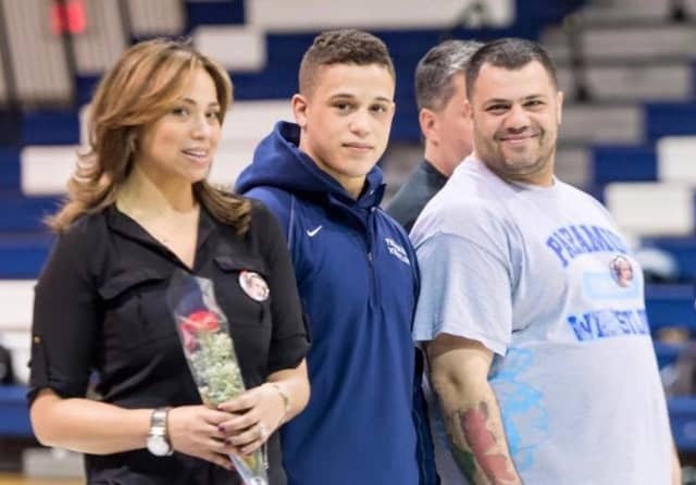Alex Sebahie with his parents, Rosie and Issa