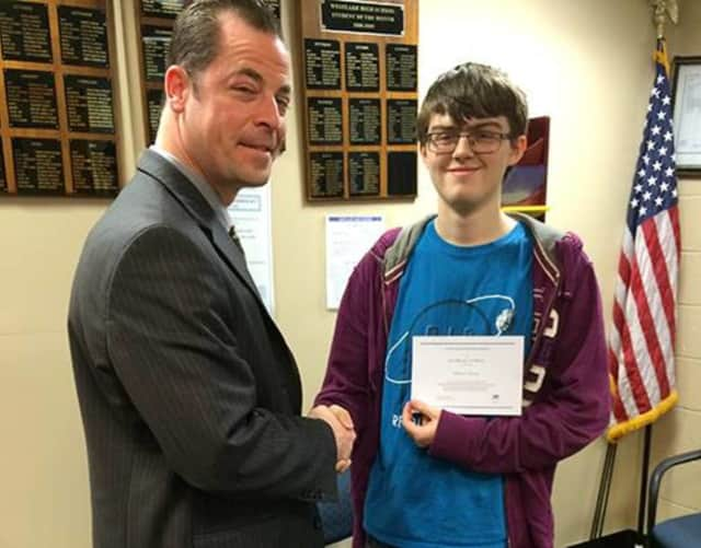 Westlake High School Principal Keith Schenker congratulates Will Sweeny on being named a finalist for the National Merit Scholarship Program.