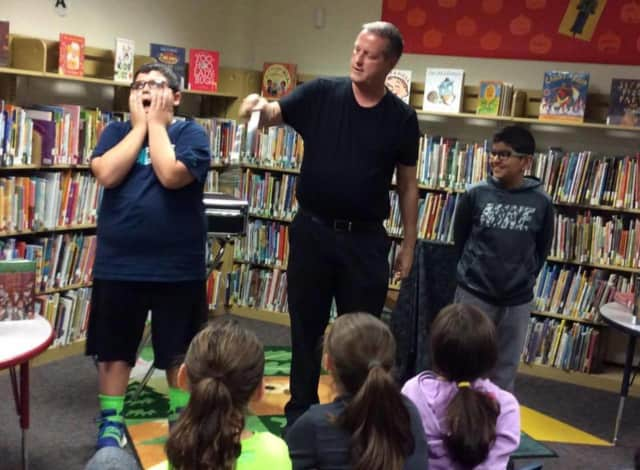 "Magician Michael Healy will entertain kids at the ""Read Across America"" event on Feb. 29."